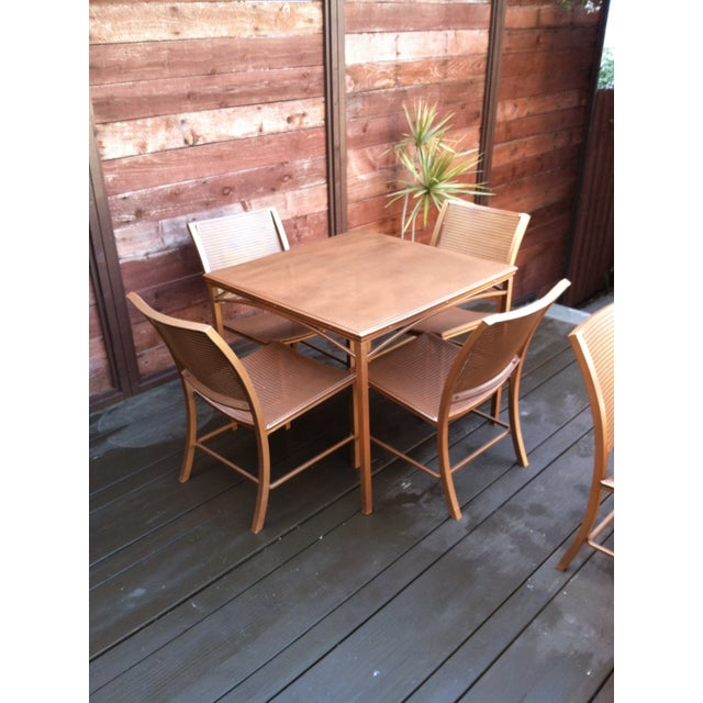 Mid century modern Brown Jordan Regent Series outdoor patio furniture set consists of a table and four chairs. All pieces...