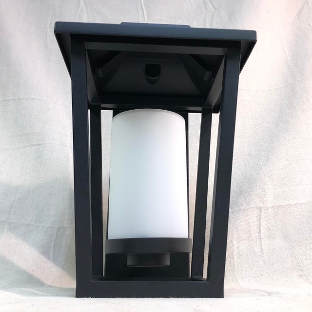 Hinkley Lighting Sullivan Outdoor Black Lantern Wall Sconce - Showroom Sample This lantern wall sconce features an...