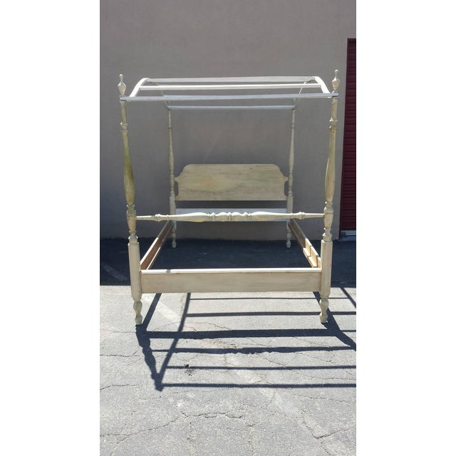 French provincial country style bed. The canopy can be removed. Painted in a light distressed lime, yellow and off-white....