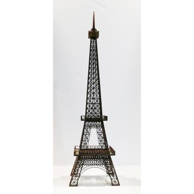 The Eiffel Tower is a wrought-iron lattice tower on the Champ de Mars in Paris, France. It is named after the engineer...