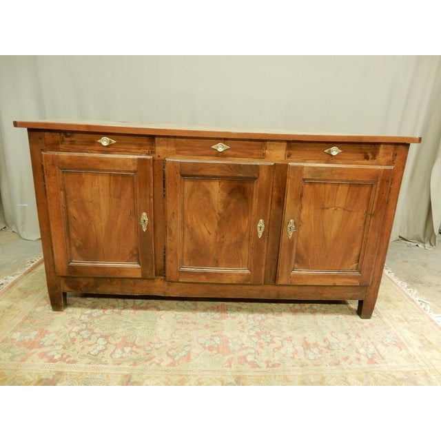 Provincial 19th c walnut enfilade. It has three doors and three drawers. The finish has been carefully restored.