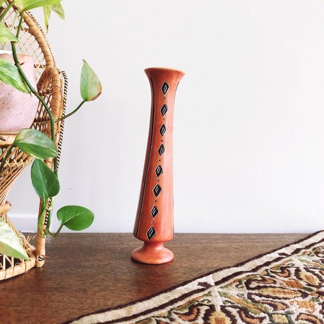 Vintage orange and black ceramic African handmade vase.