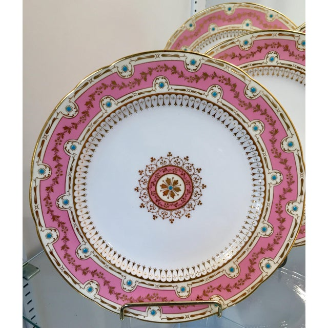 A set of 12 plates made by Minton for Tiffany. Makers Mark indicates these were made between 1901-1911. The bright pink...