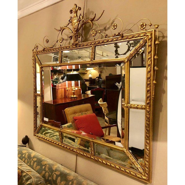 Adams style beveled mirror in a finely carved frame. The central beveled mirror flanked by a group of ten beveled framed...