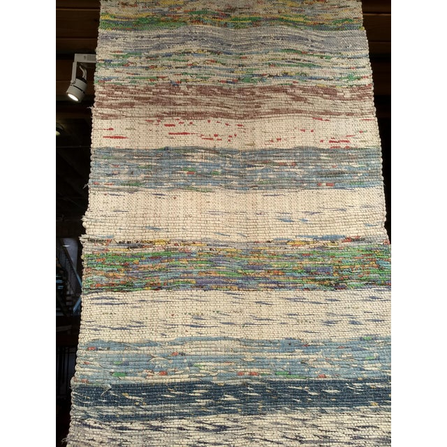 This is a vintage Turkish Kilim flat-weave rug in earth tone colored stripes. This handwoven piece has stripes in a...