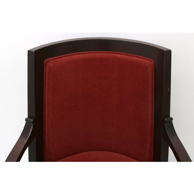 This stylish armchair was designed by Lucien Rollin and sold by the William Switzer showroom. The piece takes its lines...