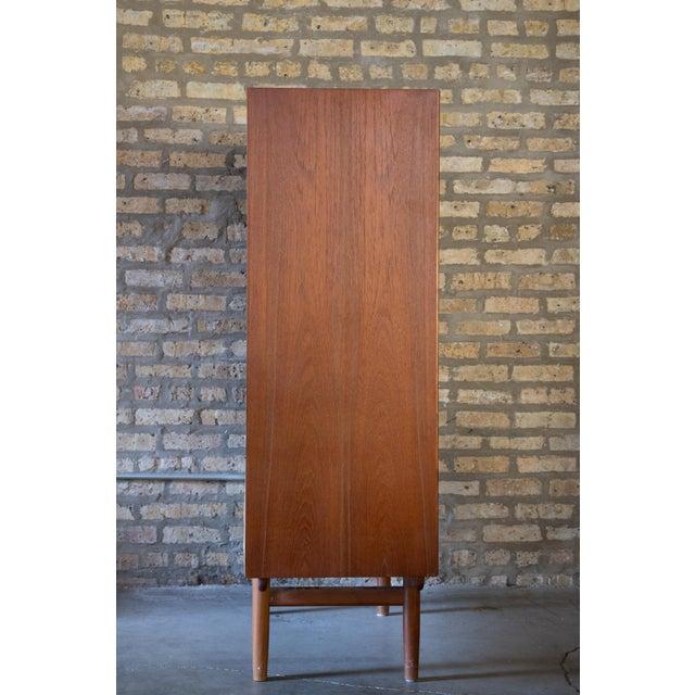 Teak dresser by Borge Mogensen for r Søborg Møbelfabrik, Denmark 1960s. A over sized tall seven (7) drawer highboy dresser...