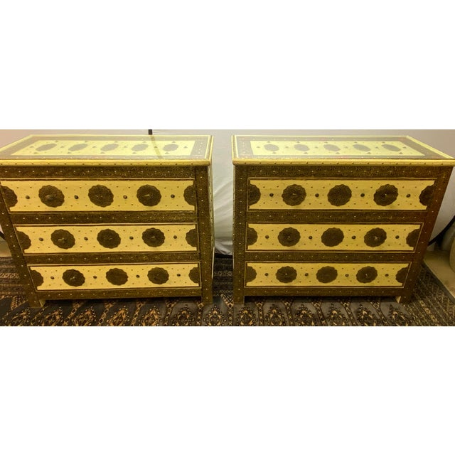 Pair of brass, natural stone and leather inlaid Moroccan off-white commodes, chests or nightstands. These exceptional...