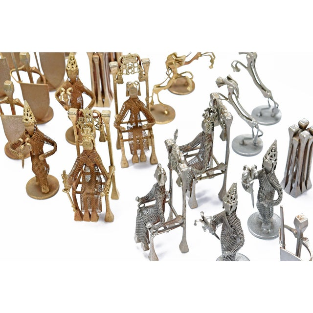 Brutalist style handcrafted steel nail silver and bronze chess set. Each individual nail has a small crown shaped chop...