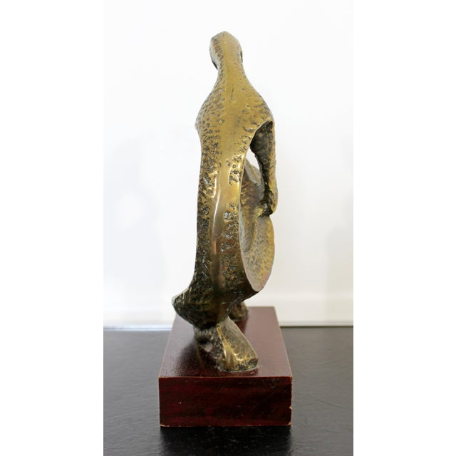 For your consideration is a beautiful, Brutalist table sculpture of a curved bronze figure. In excellent vintage...
