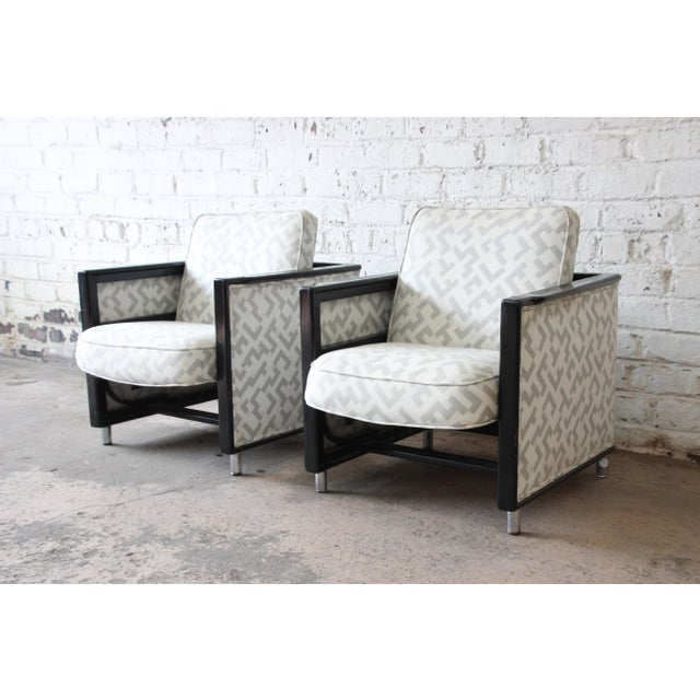 Offering a very rare and unique pair of Dunbar rocking lounge chairs by Edward Wormley. The chairs have a nice ebonized...