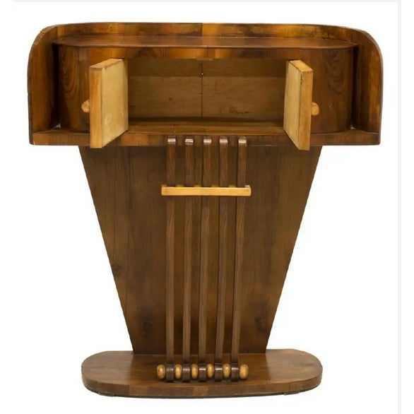 A fascinating late Art Deco period Streamline Moderne mahogany console table, designed with curves to give the allusion of...