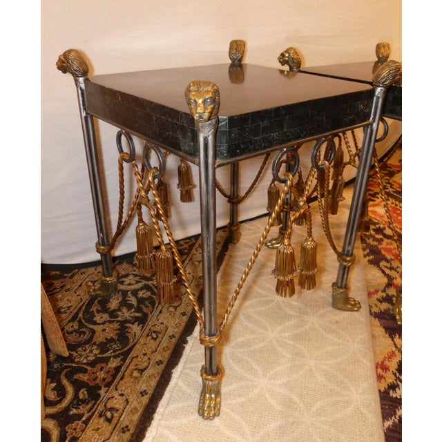 Fabulous and unusual pair of Hollywood Regency side tables by Maitland Smith. Tessellated marble top with four brass lions...