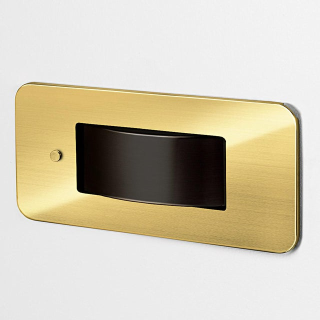 A brushed brass bedside recessed reading light with a push button switch. The switch allows the central light housing to...