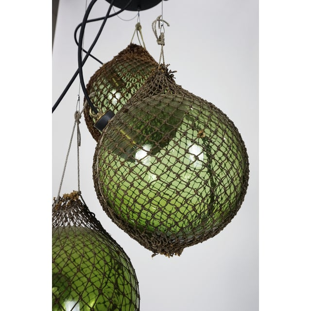 Green Antique Japanese Green Glass Fishing Floats 3-Light Pendant For Sale - Image 8 of 9