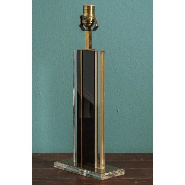 Mid-century brass and glass lamp: this handsome and unusual table lamp is fabricated from plates of clear glass, black...