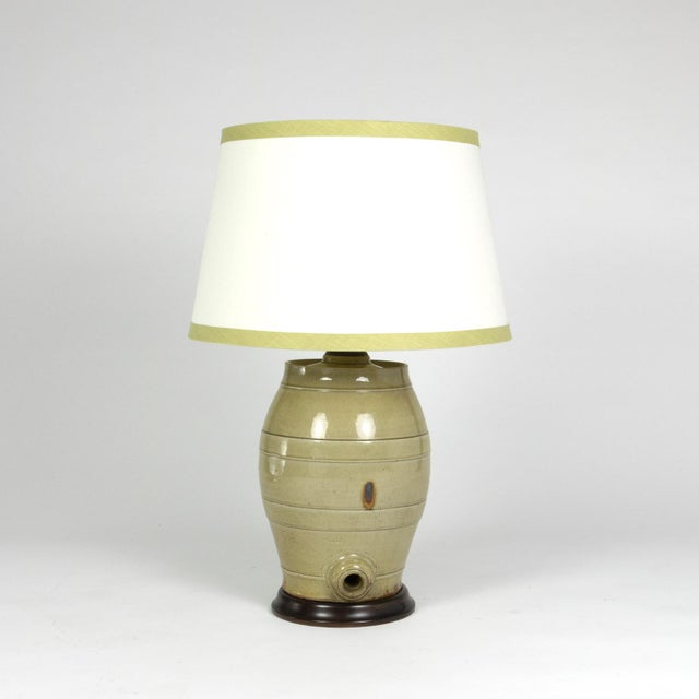Pale Green Glazed Spirit Barrel, English, circa 1880 mounted and wired as a table lamp with linen shade. Made from a...