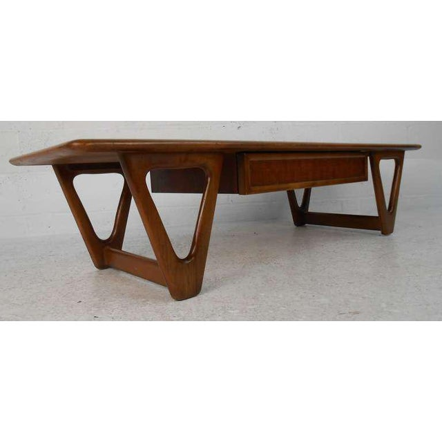 Vintage walnut coffee table with lattice-front drawer by Lane features stylish mid-century modern design by Warren Church....