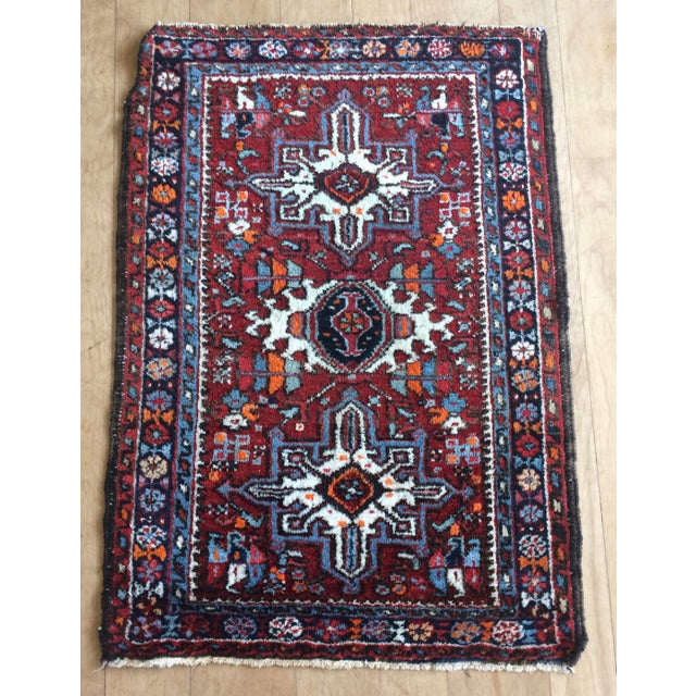 75+ years old. This little tribal mat is an artistic masterpiece. It's a great little placement mat, in the entry, laundry...