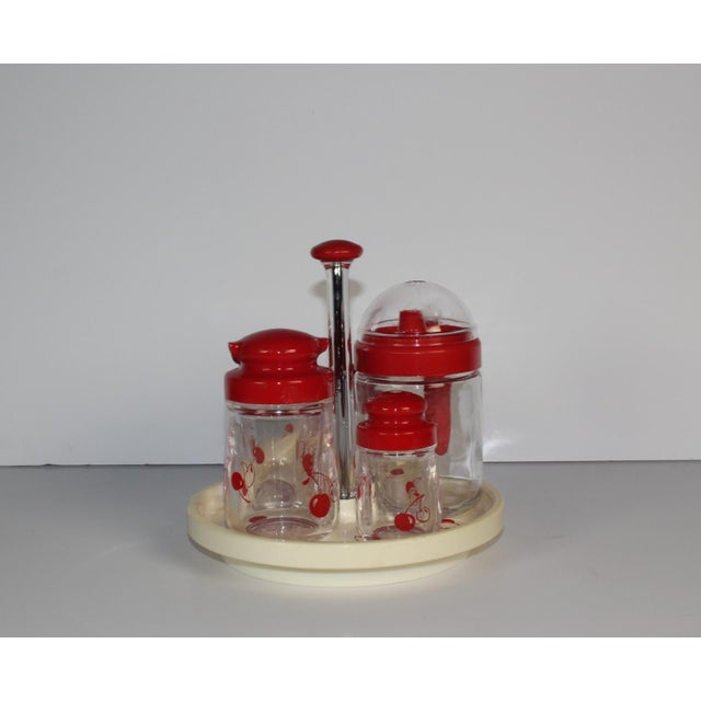 Here is a plastic set of condiment holders on lazy susan rack. Included are holders for syrup, creamer, sugar, and salt &...