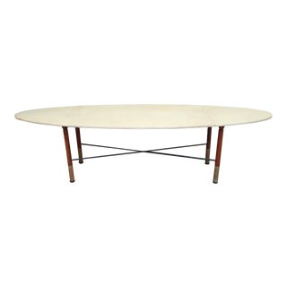 A parchment, wood and iron coffee table, Italy 70'