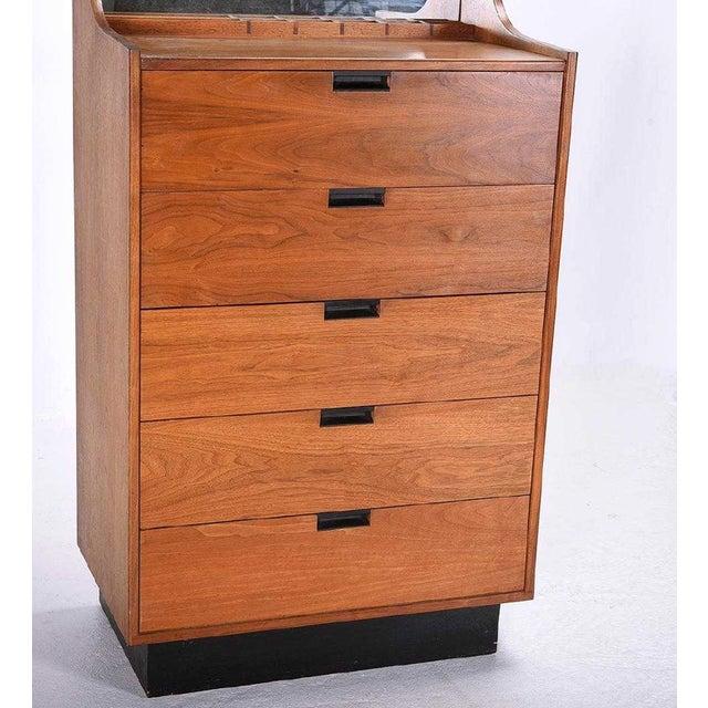 Stunning Danish Modern Dresser manufactured by Dillingham and designed by Martin Borenstein. Teak with attached mirror....