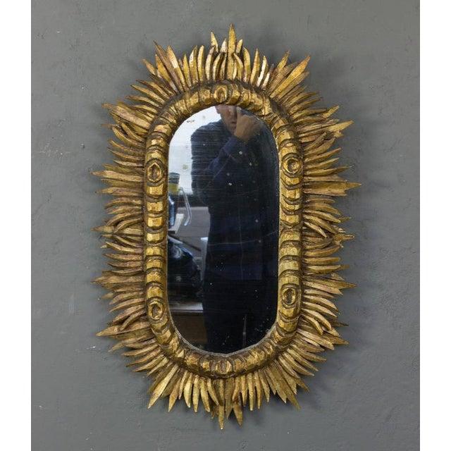 Carved giltwood sunburst mirror.