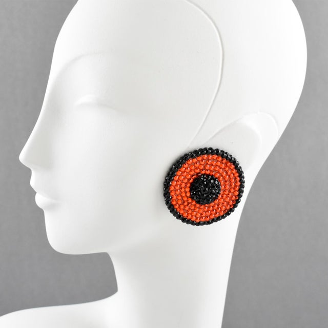 Impressive statement clip-on earrings designed by Richard Kerr in the 1980s. They are made up of his signature pave...