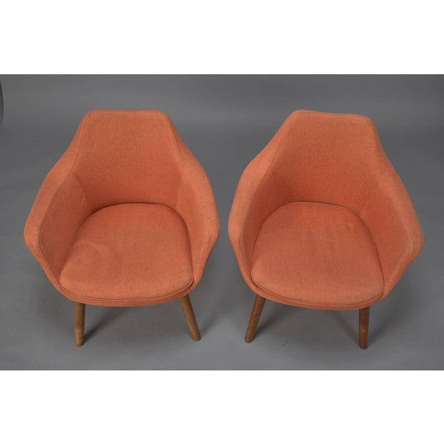 Pair of Mid-Century Modern armchairs in style of Eero Saarinen in original orange fabric.