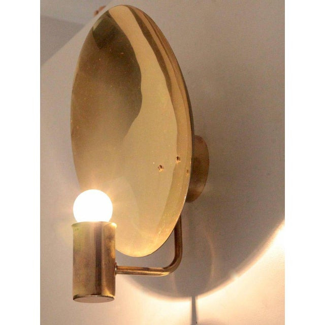 Nice pair of H.A. Jakobsson wall lamps with a brass parabol shade. Nice patina! Wiring is in good condition, but should...