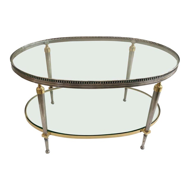 Trouvailles Steel and Brass Oval Cocktail Table For Sale
