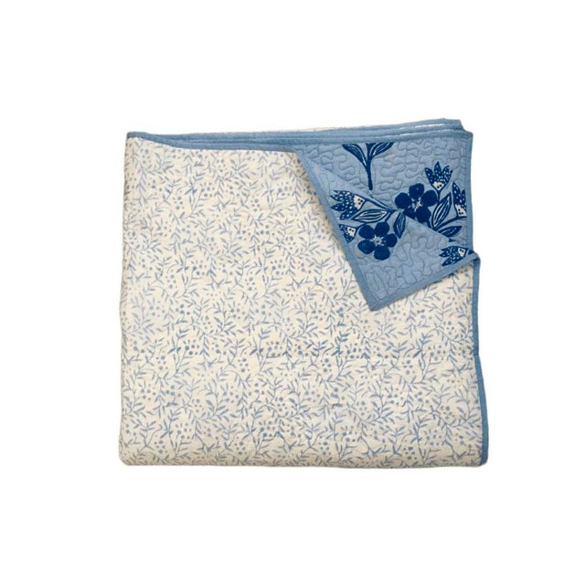 This Modern quilt is Designed by Nipa Gandhi (Canada) and block printed with sky blue dye by finest artisan from Jaipur,...
