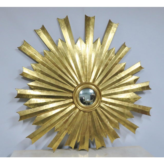 Unusual design sunburst mirror, small bullseye mirror. Carved wood gold gilt frame.