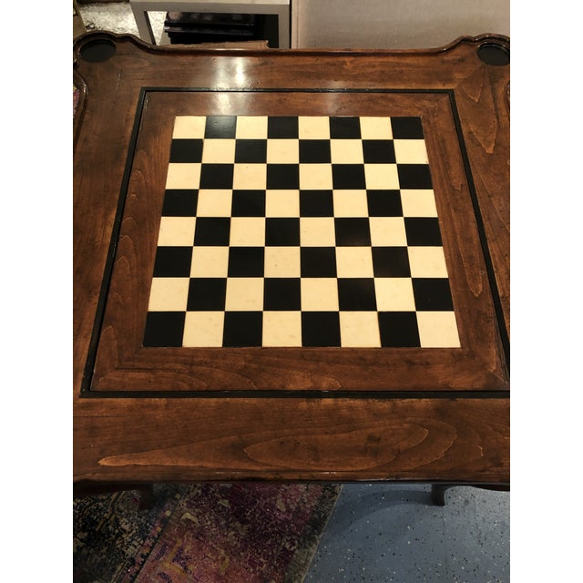 This beautiful French reproduction table offers the best of two games....Chess & Backgammon. Hand carved and produced in...