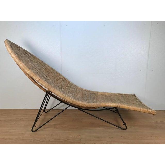 Lina Zervudachi for Elsa Schiaparelli rattan fish lounge. SEAT HEIGHT: 14 in.