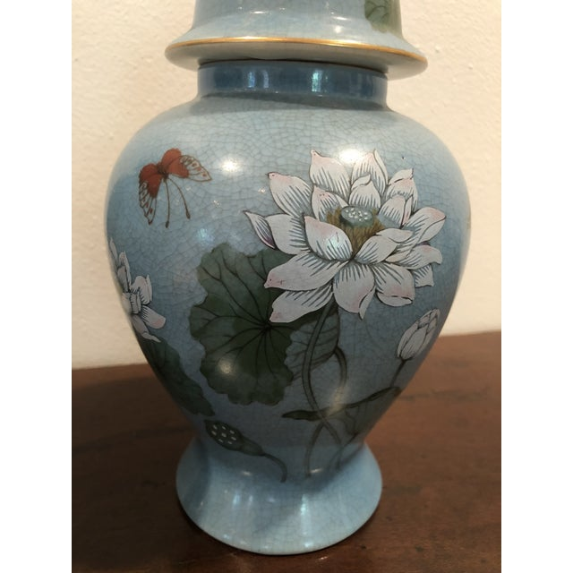 """Beautiful pair of blue ginger jars with flowers and butterflies, with """"Andrea by Sadek Made in Japan"""" stickers on both..."""