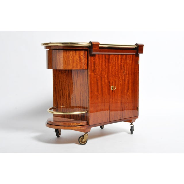 This gorgeous bar cart is from Budapest, Hungary and was made from mahogany and metal, circa 1960. The cart features 2...