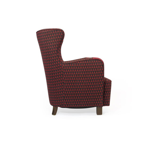 Early midcentury Danish high back lounge chair handcrafted at A.J. Iversen for Danish architect Kaj Gottlob. The chair was...