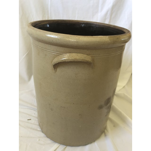 This is a beautiful mid-1800s salt glazed stoneware crock with elephant ear handles and cobalt tornado decoration and a 6...