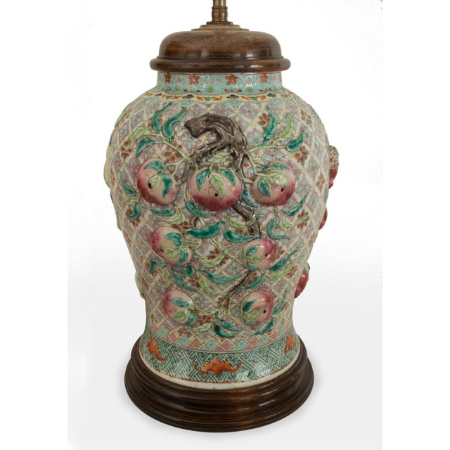 Pair of Asian Chinese style (20th Cent) large ginger jar shaped porcelain lamps with a green background and fruit in...