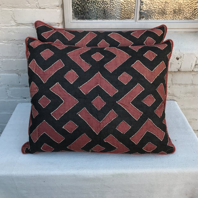 Pair of custom pillows designed by Melissa Levinson with authentic Kuba cloth combined with rust colored textured linen...