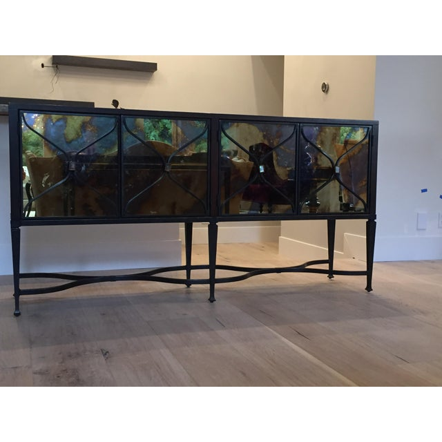 This closed storage console has mesmerizing brilliance. The Italian mirrored door fronts have been fumed in whips of smoke...