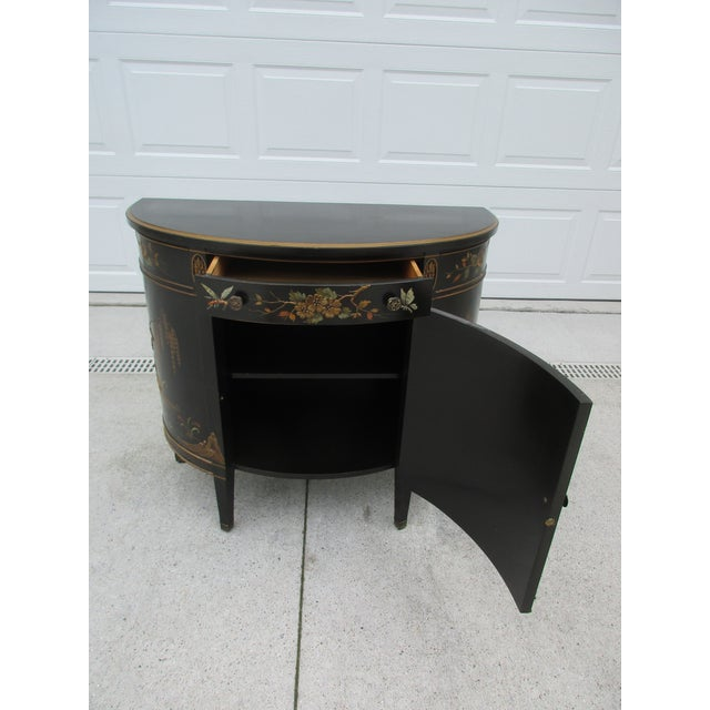 This beautiful black lacquered Chinoiserie style commode or cabinet is by Imperial Furniture out of Grand Rapids,...