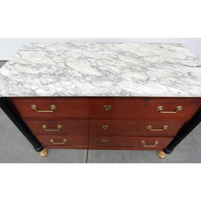 19thC French Directoire style 3 drawer marble top commode with gilt and ebonized accents.