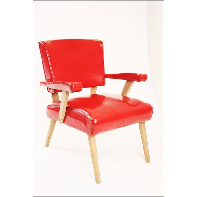 Mid Century Modern Chair. Solid blonde hardwood. Streamline straight legs. Large red vinyl seat and back cushion. Padded...