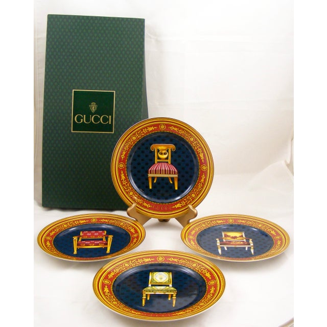 Here are 4 gorgeous Gucci porcelain plates with antique chair motifs. The predominant colors of each plate are navy,...