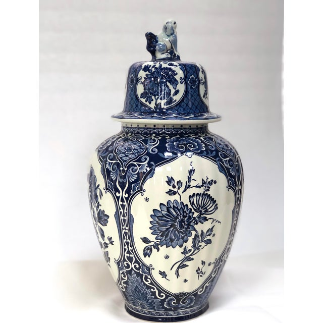 Gorgeous Delft blue and white vase made for Royal Sphinx, Belgium. Large lidded pot is hand painted on four sides with...
