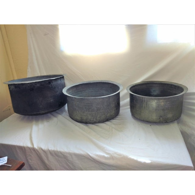 Three antique cooking basins with charred bottoms. From Ceylon 1940's They are primitive hammered pots with a bit of rough...