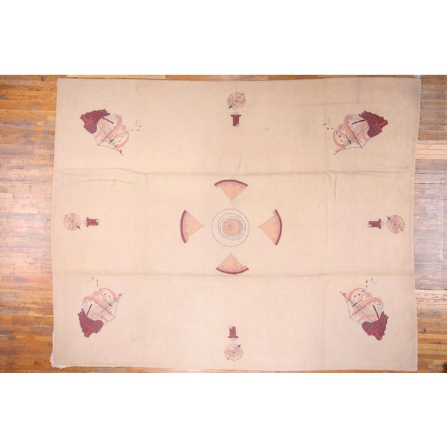 American hooked rug with a nautical design. White background and ivory designs.