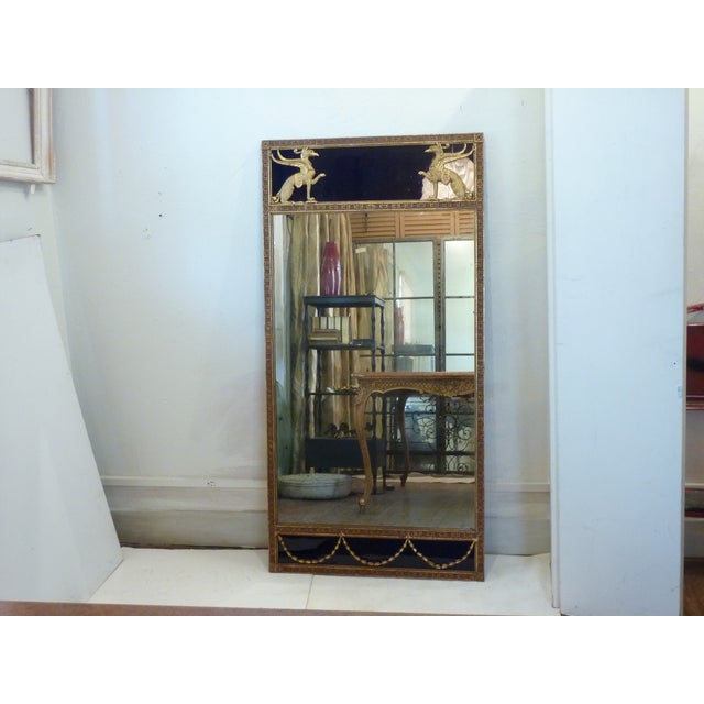 This is an early 20th century Art Deco mirror. The piece features deep cobalt glass at the top and bottom and Egyptian...